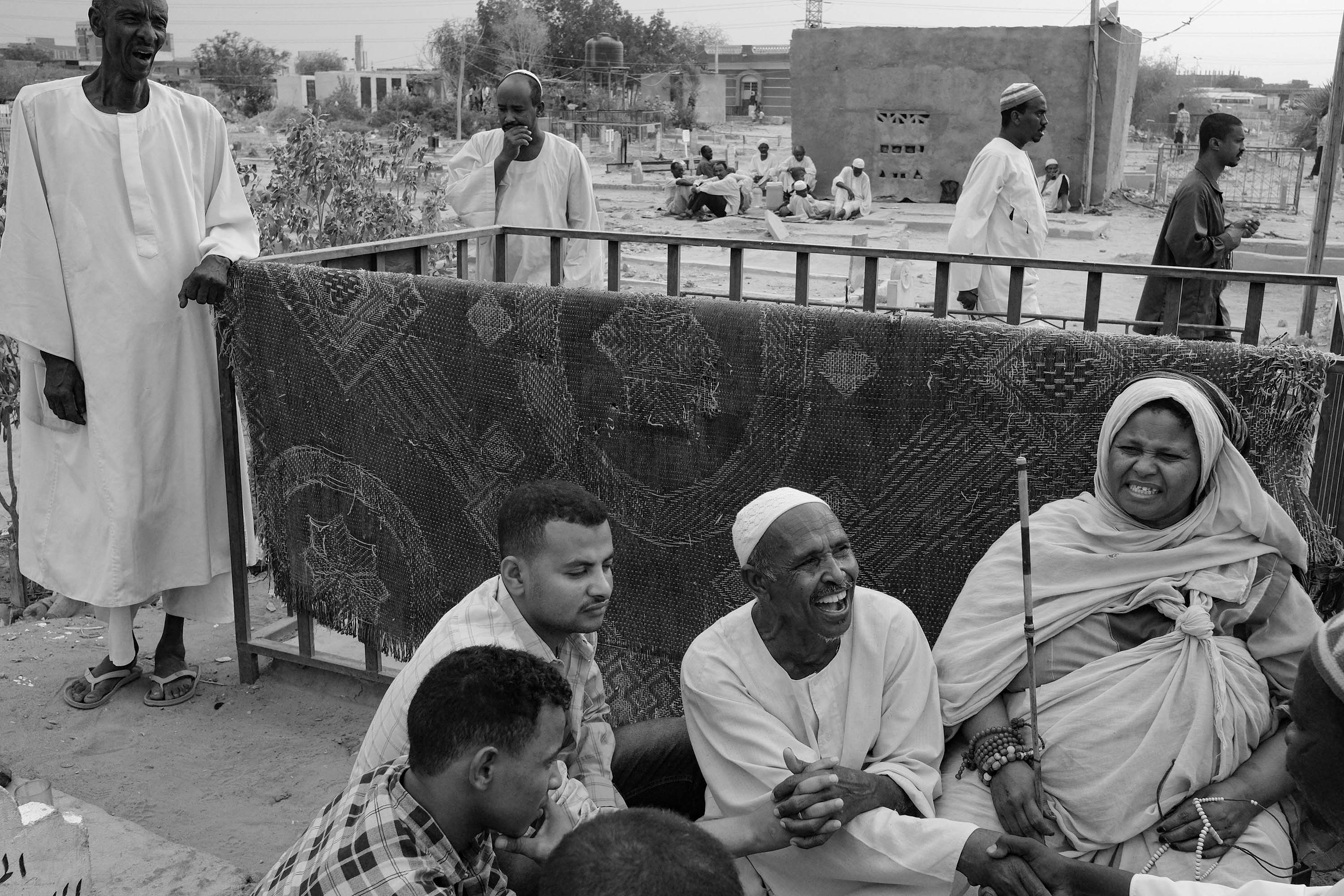 09. People sing and pray in the middle of a cemetery. Most Sufi gatherings take place in or around cemeteries. Omdurman. Sudan. 2017