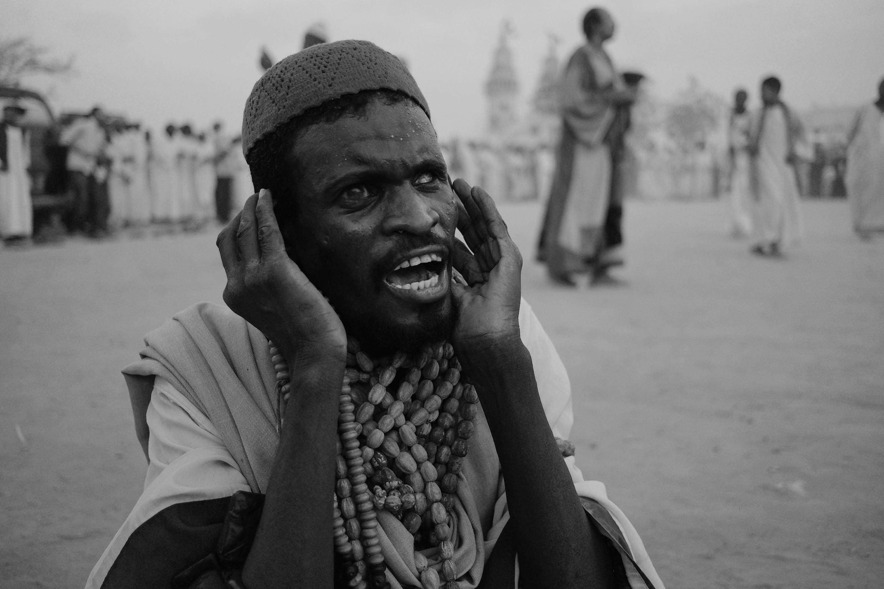 10. Participant of ''Zikr'' screams in excitement. Omdurman. Sudan. 2017