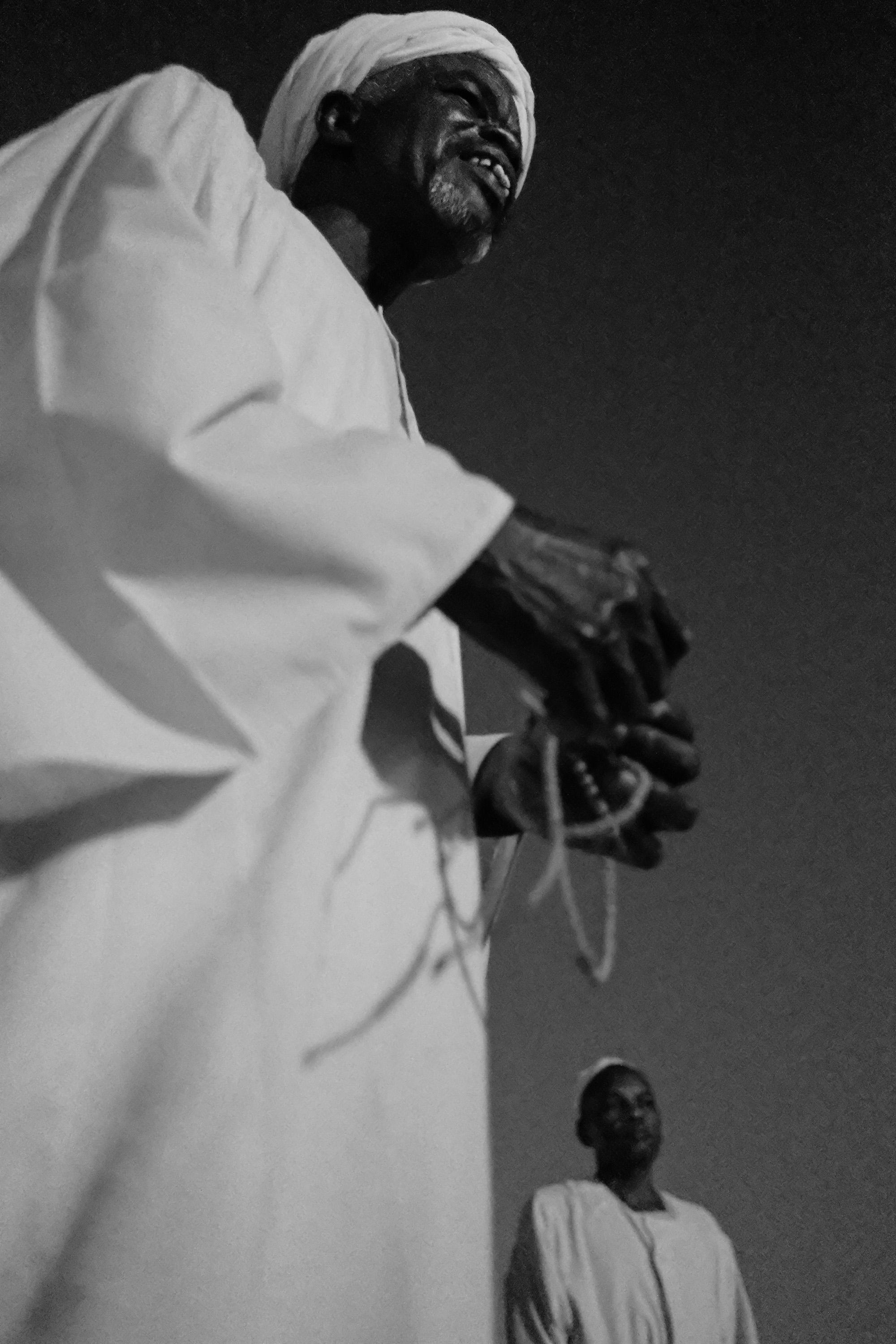 13. Man holds his prayer beads. Omdurman. Sudan. 2017