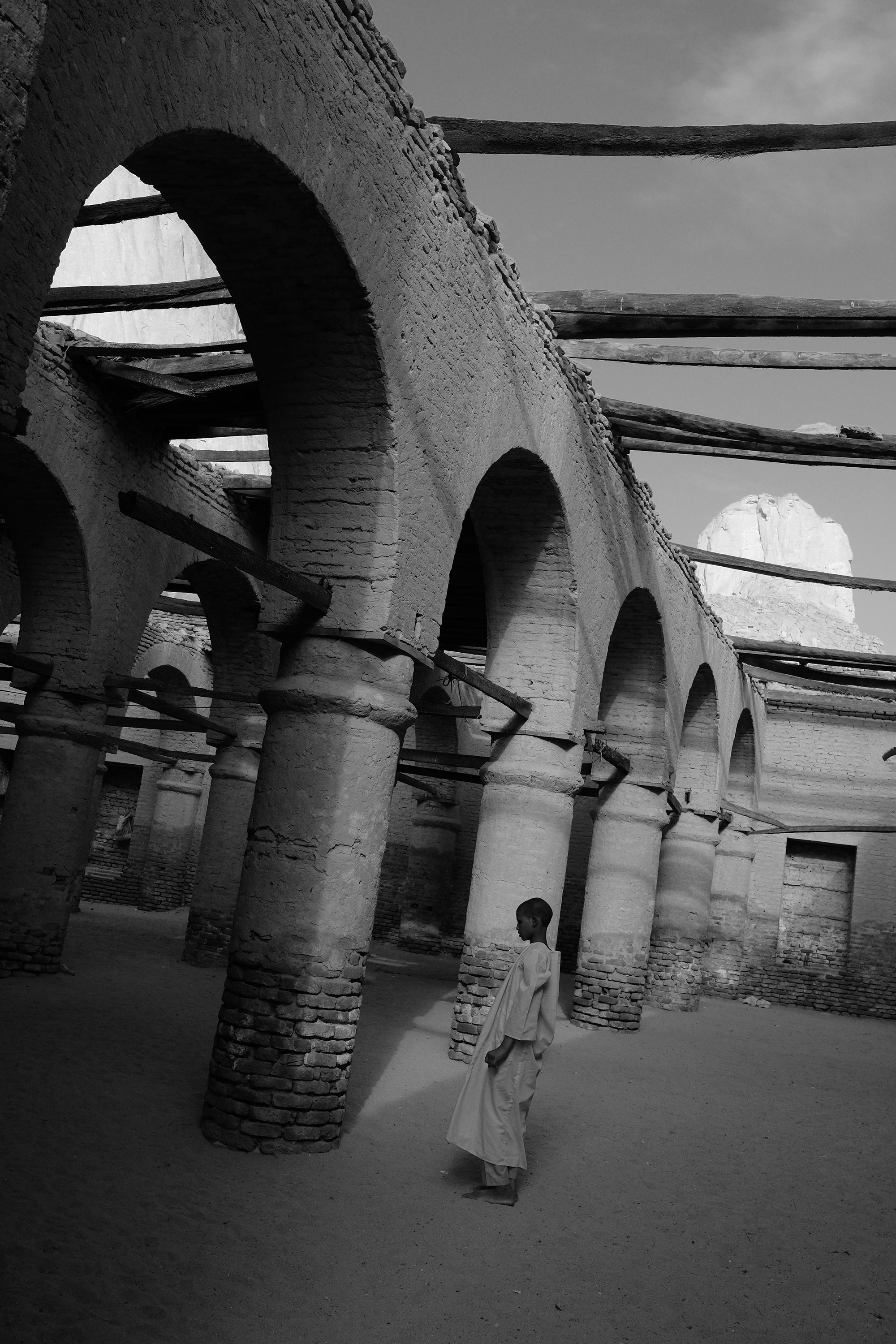 22. Boy prays at the crumbling Khatmiya mosque. Kassala. Sudan. 2017