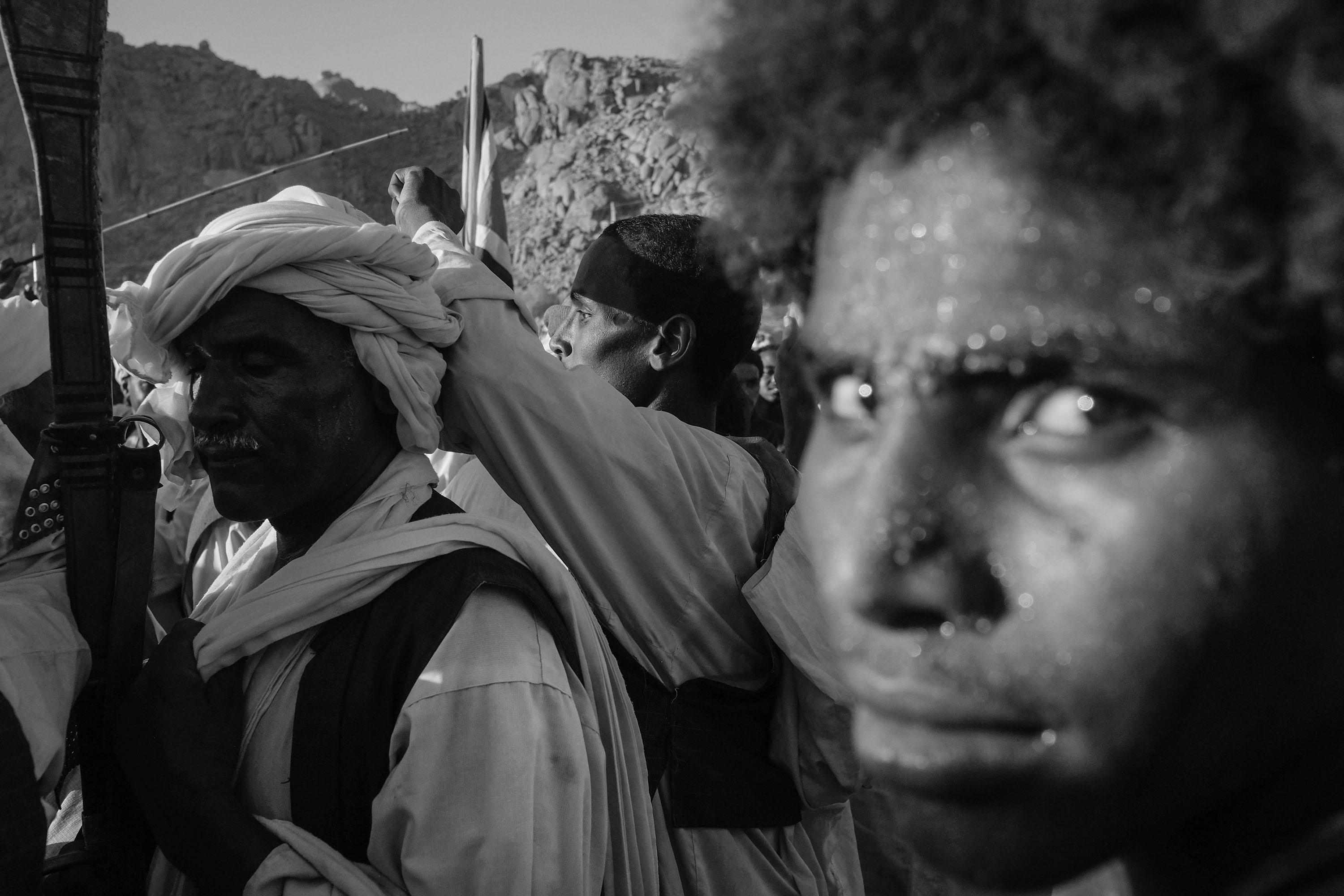 24. Sweat covers the faces of the most active dancers of the Sufi gathering. Kassala. Sudan. 2017