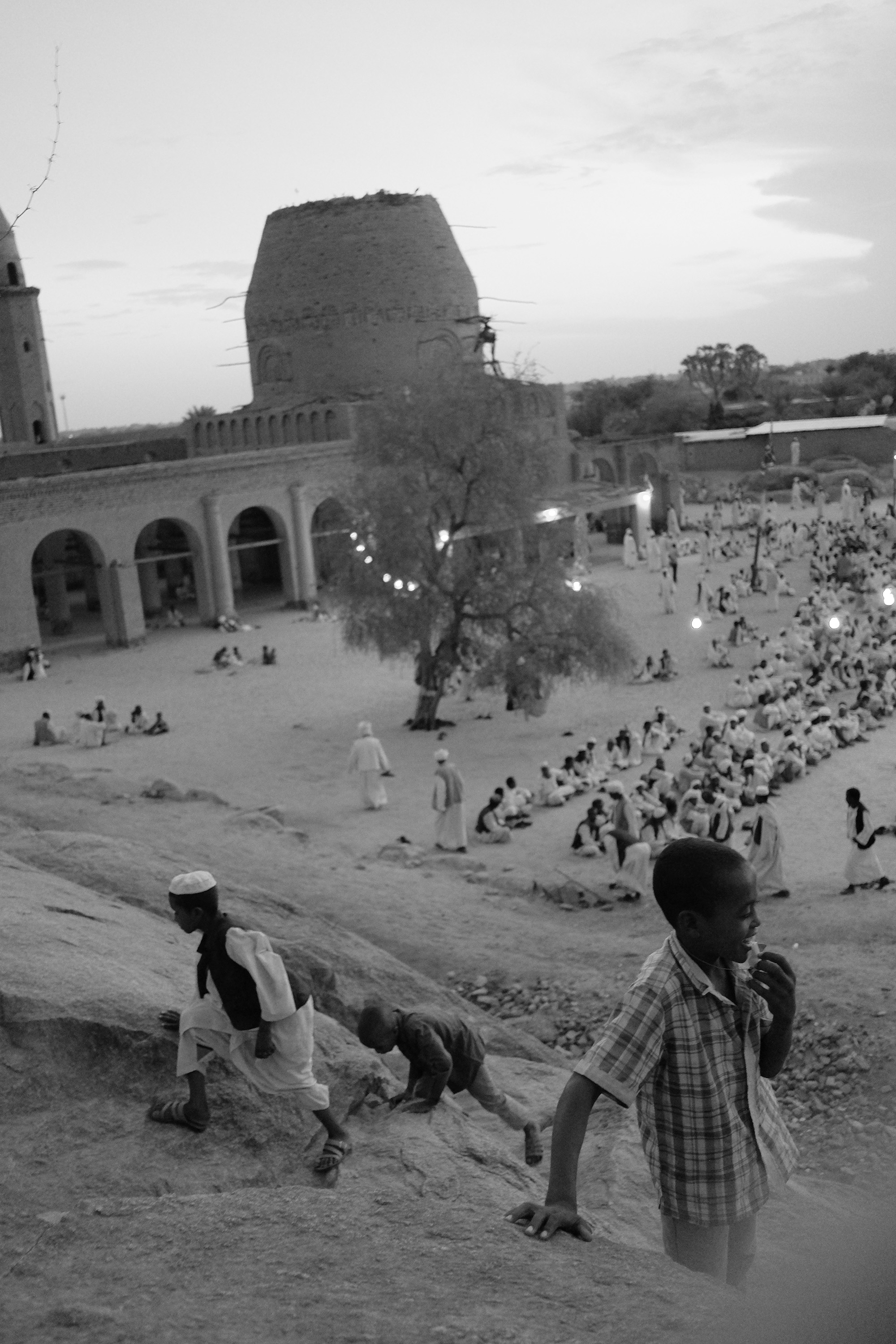 25. Kids play while the elders pray. Kassala. Sudan. 2017