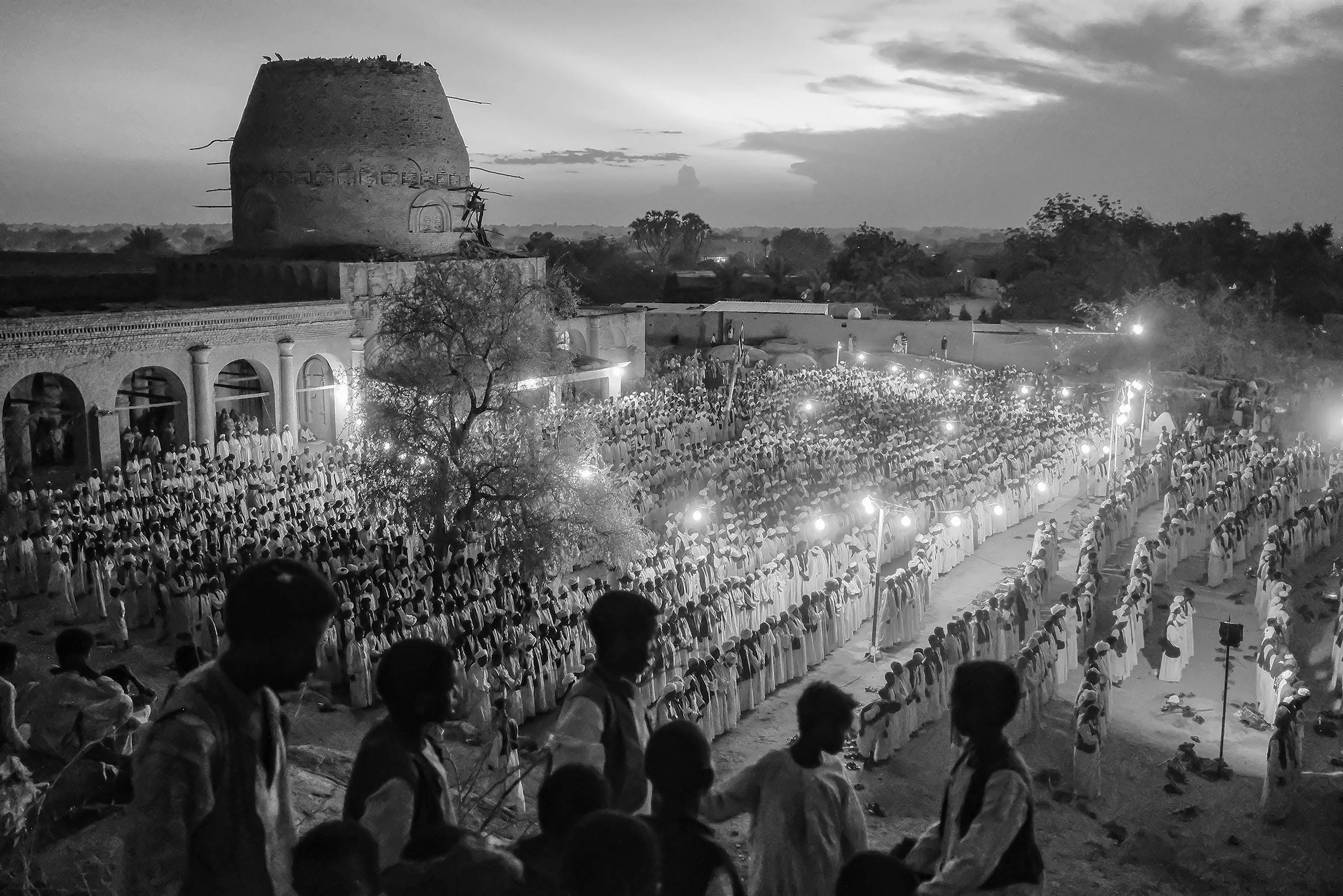 29. Hundreds of Sufi devotees participate in the evening prayer. Kasalla. Sudan. 2017